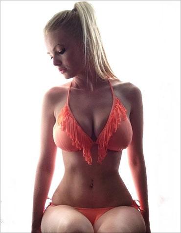 zienna-sitting-on-her-legs-370